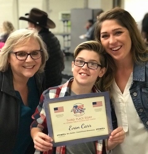 Evan Carr with his teacher (left) and mother (right)